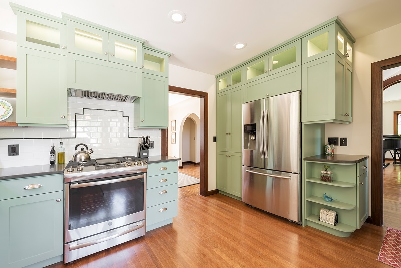 Arches, Arch ways, Kitchen Remodels, Colorful cabinets, mint green cabinets, Tudor Kitchen | Renovation Design Group