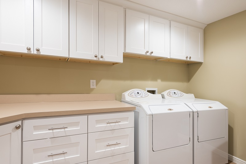 After an Interior Laundry Room remodel, Basement Laundry in a Mid Century Home renovations | Renovation Design Group