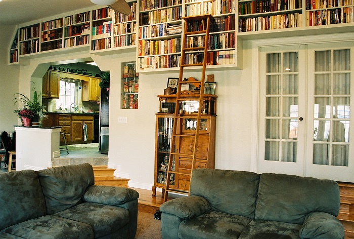 Living room Library with transition steps from kitchen