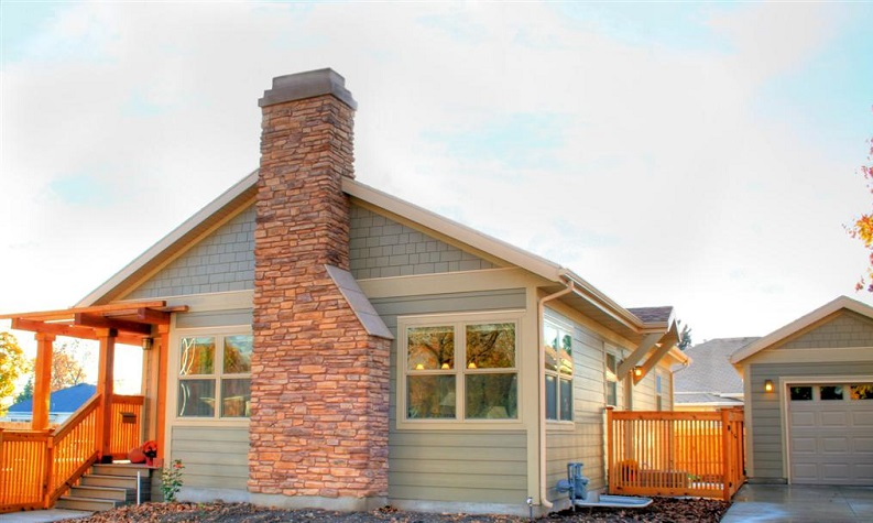 Exterior Home Remodel brick Chimney on Cottage home | Renovation Design Group