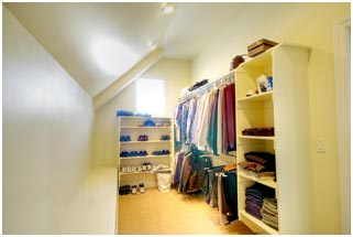 1800 East Cape Interior Master Suite Closet by Renovation Design Group