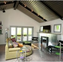 contemporary vaulted ceiling, fireplace, living space