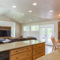 Sat Lake City Utah After remodeling the kitchen in a split level granite counter, custom cabinets, pendant lights, natural lighting