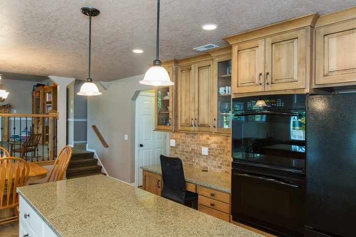 Sat Lake City Utah After remodeling the kitchen in a split level granite counter, double oven, custom cabinets, pendant lights