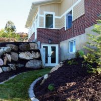 After_Exterior_Landscape Remodels_Lower Level Entry_Split Entry Home Exterior | Renovation Design Group