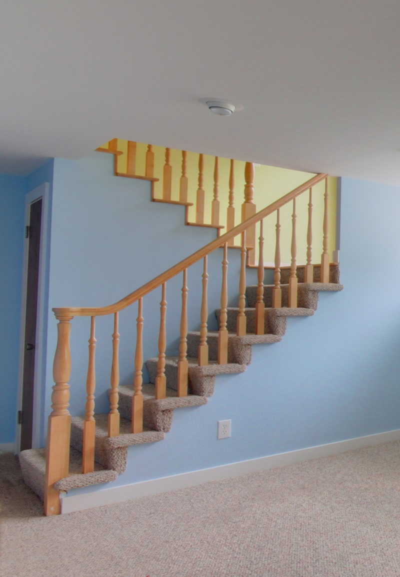 Contemporary Ranch home remodel split stairs into basement   Renovation Design Group