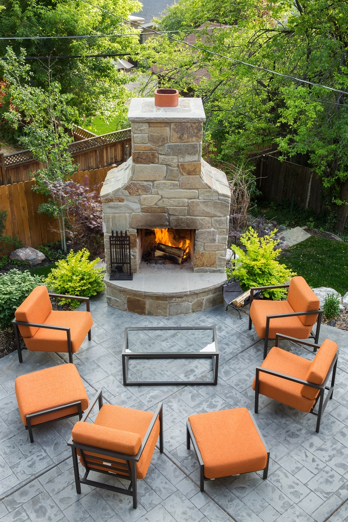 After_Exterior_Outside Fireplace_Bungalow Remodels | Renovation Design Group