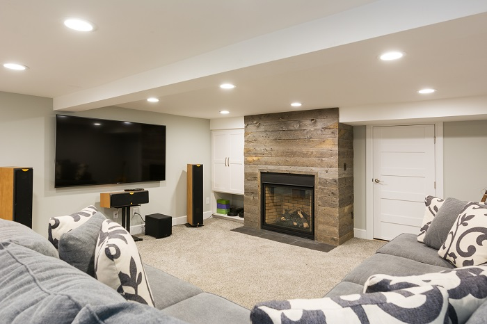 After_Interior_Basement Family Room_Bungalowwood plank fireplace | Renovation Design Group