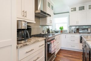 Cottage Kitchen Remodel White Cabinets Contemporary hardware | Renovation Design Group