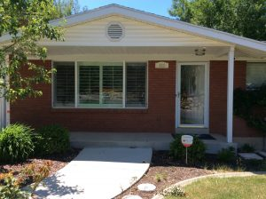 Before exterior Oakleaf Ranch home | Renovation Design Group