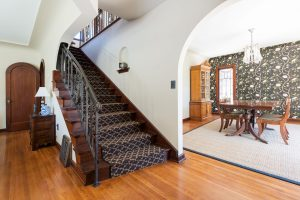 Staircase to second floor, Tudor, Entry Way, Full Stairs, Hard Wood, Bold Wallpaper | Renovation Design Group