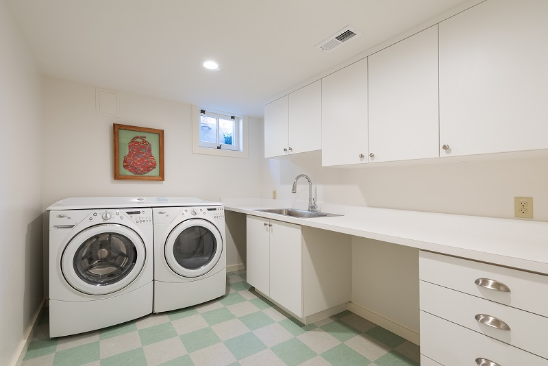 Basement Laundry Rooms, Storage in laundry Room, Tudor, Checkered Tile Flooring | Renovation Design Group
