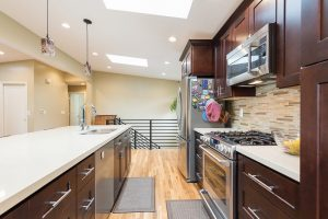 After remodeling the Interior Kitchen with Skylights, Great Room remodel in a Mid Century Home