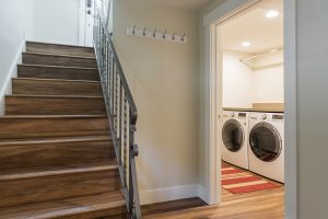 After Interior Split Stairs Basement Remodel Mudroom Laundry Room Wood Floors Bungalow | Renovation Design Group