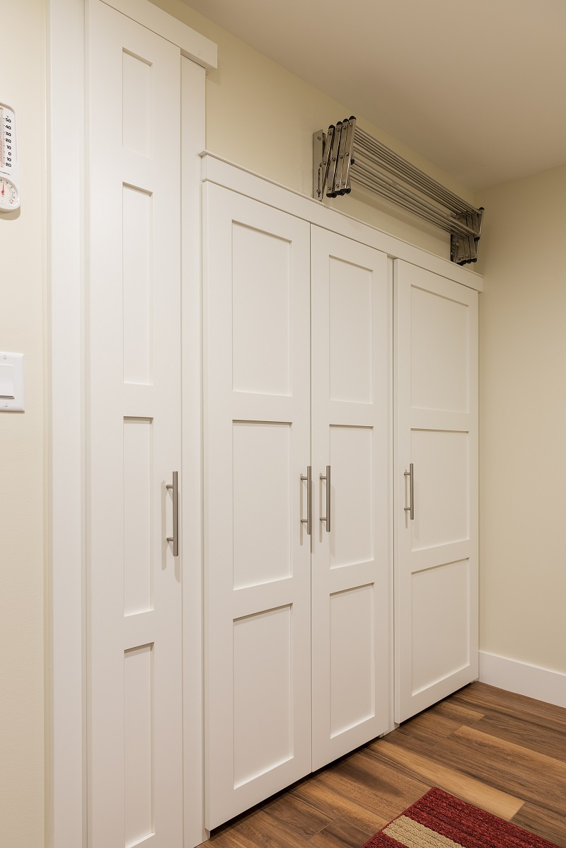 After Interior Storage Laundry Room Basement Apartment remodel | Renovation Design Group