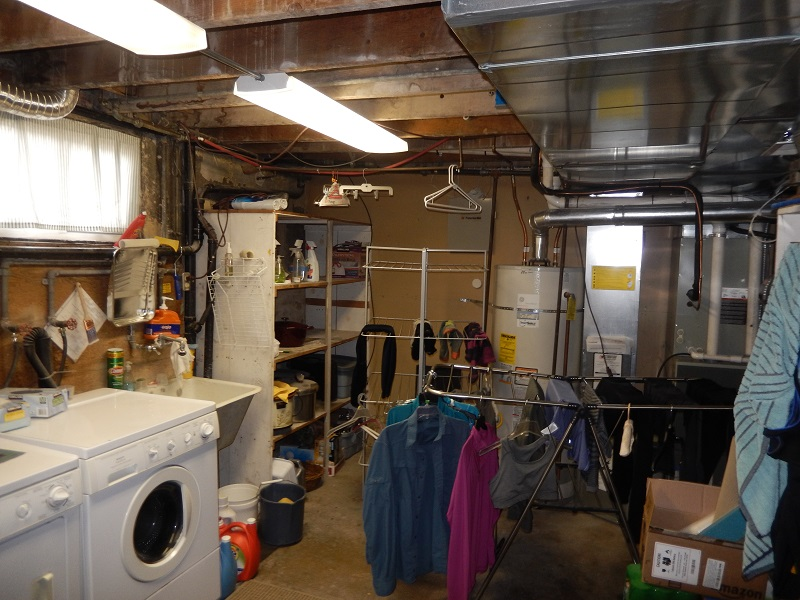 Beore interior Basement Bungalow Remodelsed Basement Mother in law laundry | Renovation Design Group