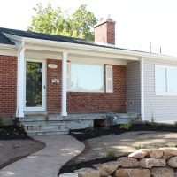 After, Exterior, Enclosed kitchen above garage, Cottage Exterior | Renovation Design Group