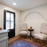 Basement entry with white painted exposed brick