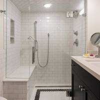 Black and white tiled basement bathroom