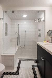 Black and white tiled basement bathroom