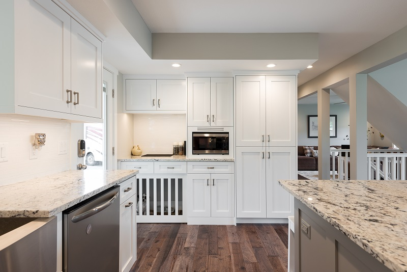 Cape Home, Open floor Plan, Kitchen remodels, Great room, white cabinets, modern designs, custom dog entrance | Renovation Design Group