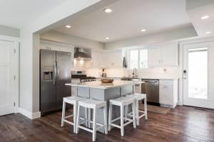 Cape Home, Open floor Plan, Kitchen remodels, Great room, white cabinets, modern designs | Renovation Design Group