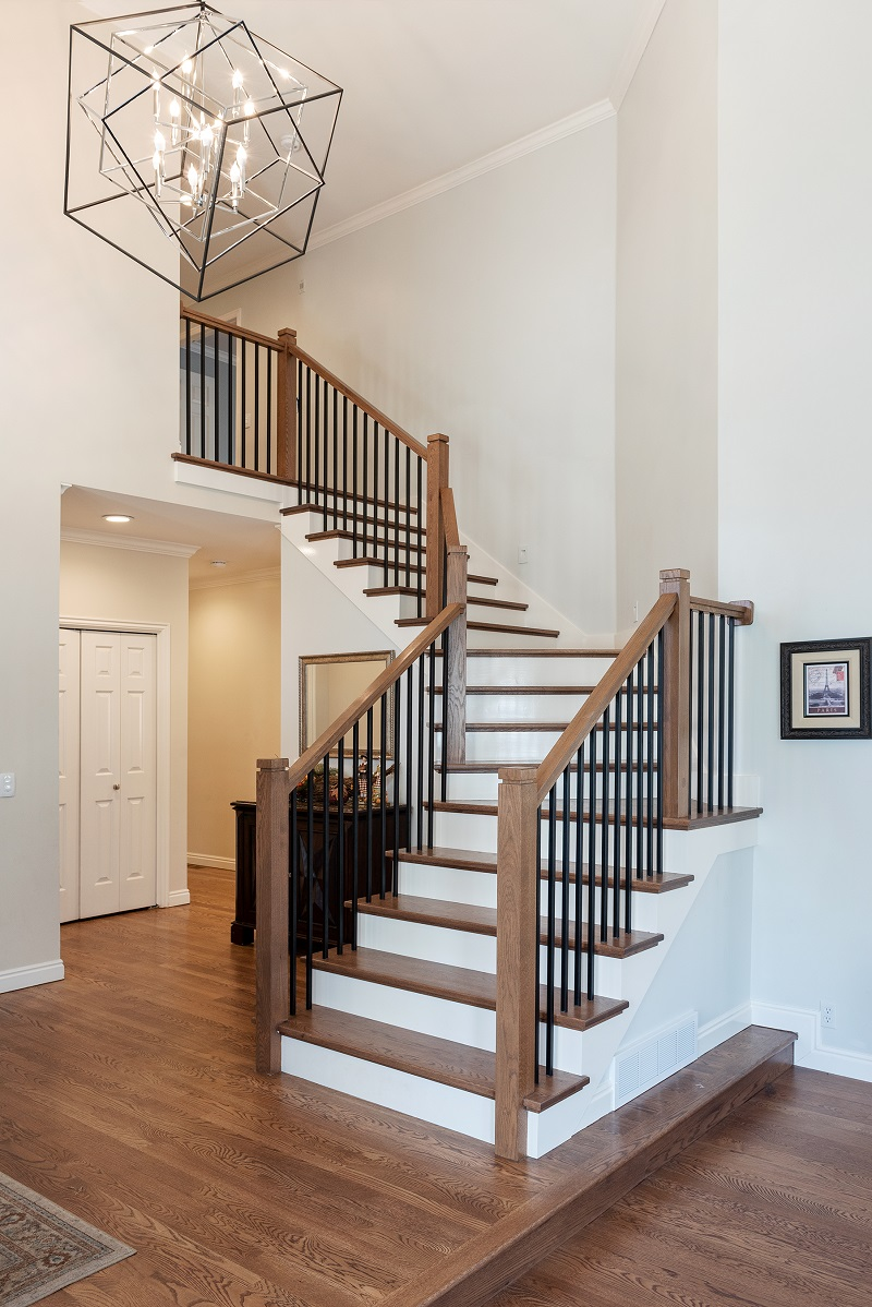 Front entry and modern staircase ideas   Renovation Design Group