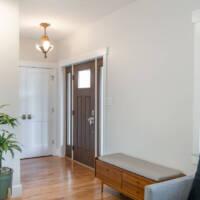 Entry way, new door, modern flooring, modern furniture