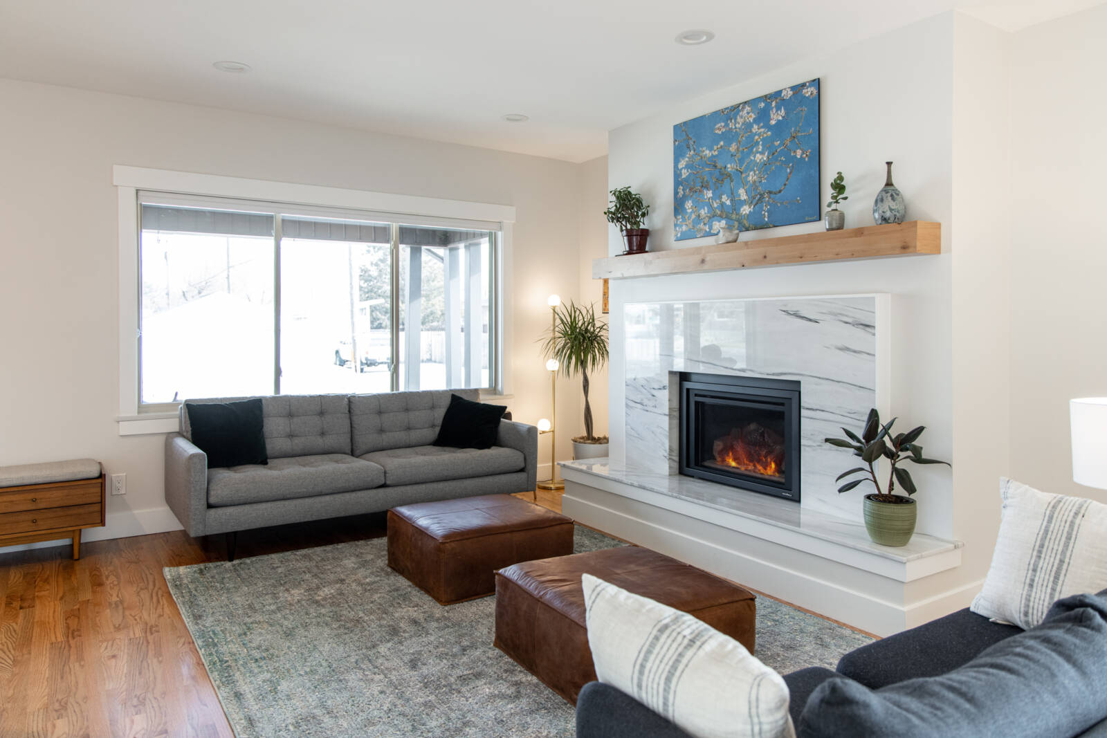 Marble slap fireplace, contemporary furniture, Fireplace ideas, natural light, floating shelves