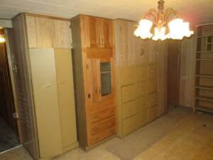1970's designed and styled basement, built in file cabinets