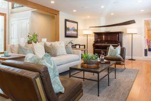 After Remodel Living Room Indoor pool | Renovation Design Group
