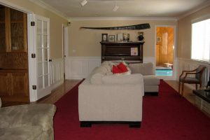 Before Remodel Living Room Indoor pool | Renovation Design Group