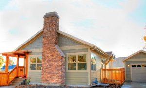 Exterior Home Remodel brick Chimney on Cottage home | Renovation Design Group