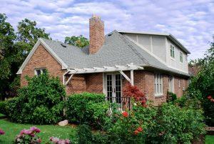 Porch Back Exterior Tudor Brick | Renovation Design Group