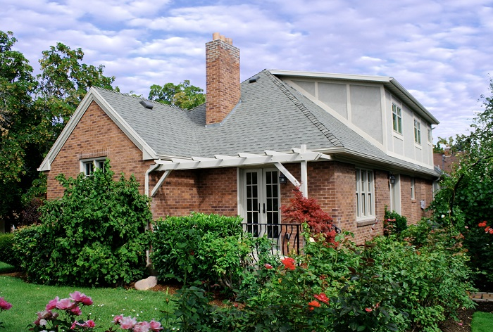 Porch Back Exterior Tudor Brick | Renovation Design Group