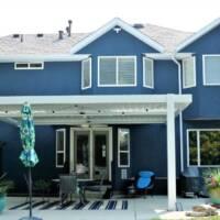Retractable Pergola and Blue Stucco