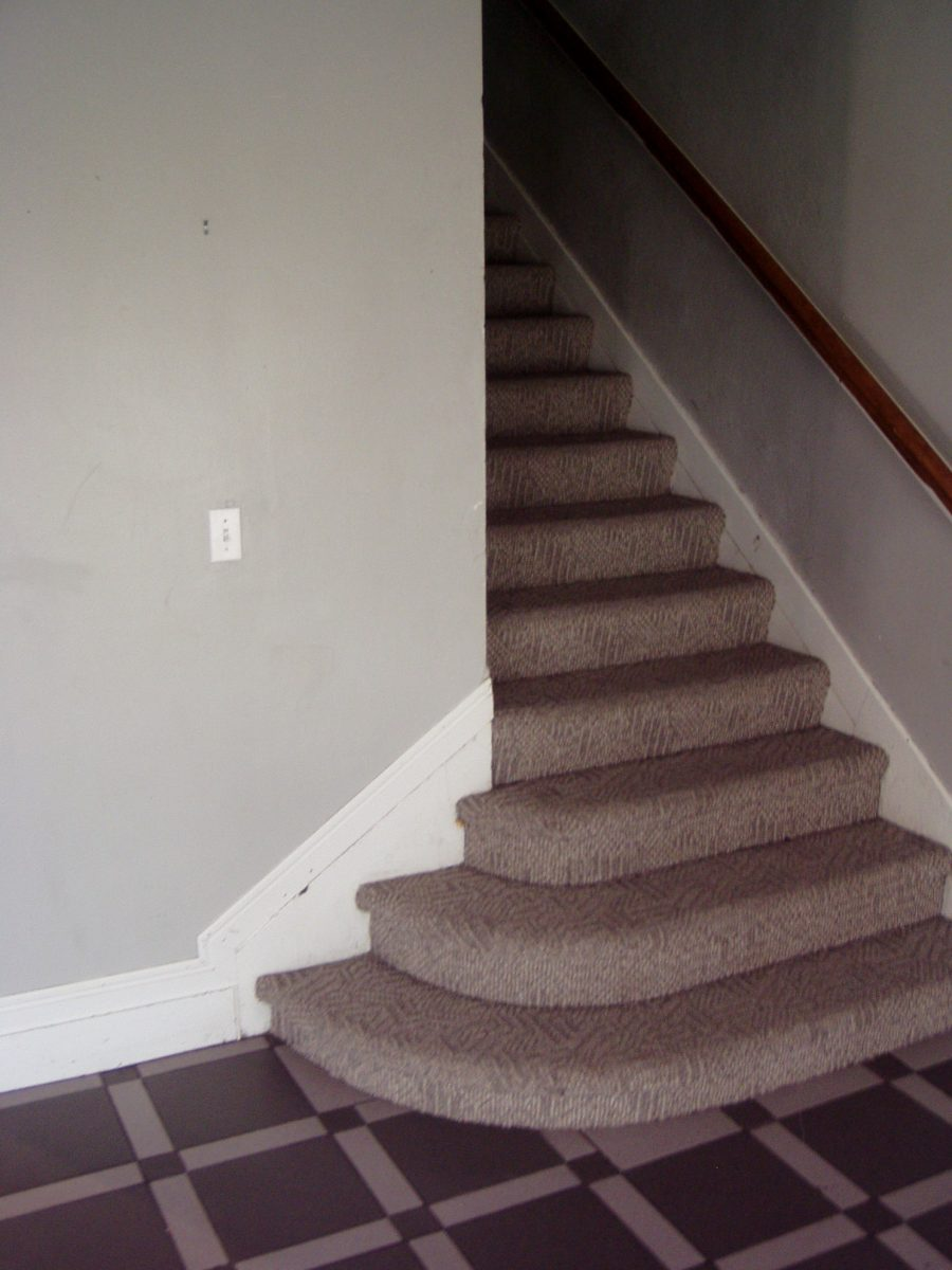 Before Staircase Renovated Frat House | Renovation Design Group