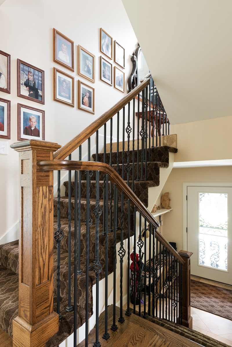 Stair case second story adition on Tudor home | Renovation Design Group