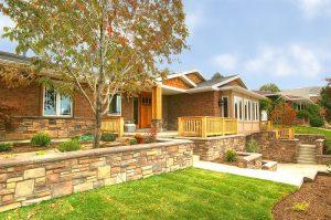 Exterior ranch stone clad retaining walls | Renovation Design Group