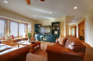 family room with tv and entertainment center | Renovation Design Group