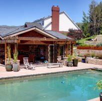 After_Exterior Renovation_Backyard_Pool House Remodel | Renovation Design Group