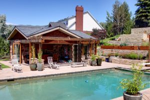 After_Exterior Renovation_Backyard_Pool House Remodel | Renovation Design Group