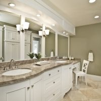 Large bathroom with Double sink and silver hardware with white tile floors | Renovation Design Group