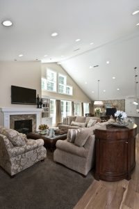 Great room with high ceilings, natural light, fireplace, and modern traditional style | Renovation Design Group