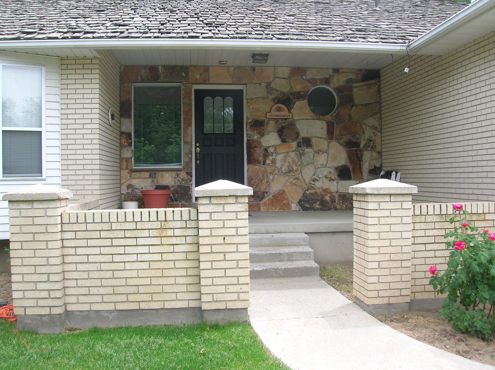Cape Home Stone porch Before exterior remodel | Renovation Design Group