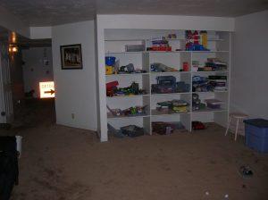 Befoe Family room remodel with built in shelves | Renovation Design Group