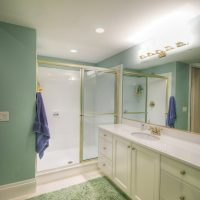 Bathroom Designs After_Interior_Green Bathroom_Cape Home | Renovation Design Group