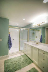 Bathroom Designs After_Interior_Green Bathroom_Cape Home | Renovation Design Group