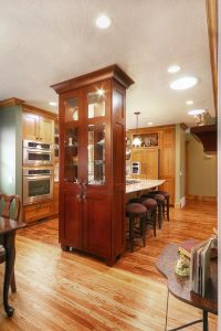 Great Room Renovation dark wood with bar stools, dining area and open floor plan | Renovation Design Group