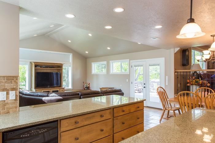 Sat Lake City Utah After remodeling the kitchen in a split level granite counter, custom cabinets, pendant lights, natural lighting | Renovation Design Group